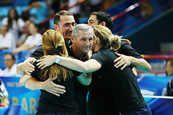 Azerbaijan coach Aleksandr Chervyakov celebrates with his staff