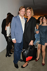JACQUETTA WHEELER and her husband JAMIE ALLSOPP at the launch of The Lulu Perspective to celebrate 25 years of Lulu Guinness held at 74a Newman Street, London on 13th September 2014.