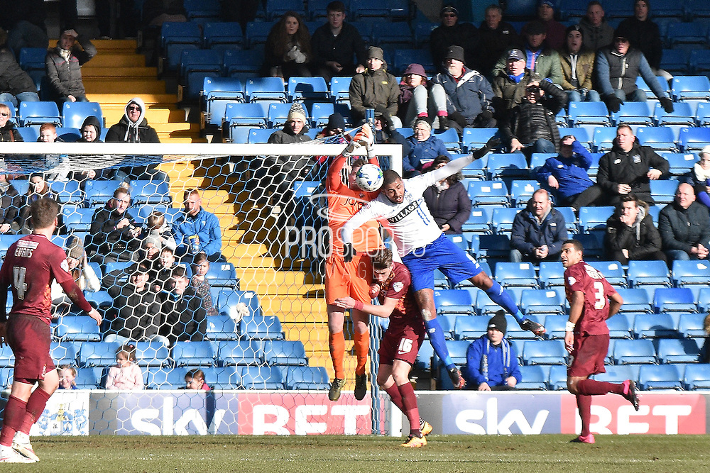 Bradford City Goalkeeper, Ben Williams and Bury Forward, Leon Clarke tangle in the area during the Sky Bet League 1 match between Bury and Bradford City at the JD Stadium, Bury, England on 5 March 2016. Photo by Mark Pollitt.
