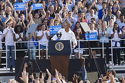November 2, 2016 - Chapel Hill, NC, USA - President Barack Obama slaps the side of his podium after delivering a speech while campaigning for Democratic presidential candidate Hillary Clinton at Michael Hooker Fields on the campus of UNC-Chapel-Hill Wednesday, Nov. 2, 2016 in Chapel Hill, N.C. (Credit Image: © Travis Long/TNS via ZUMA Wire)