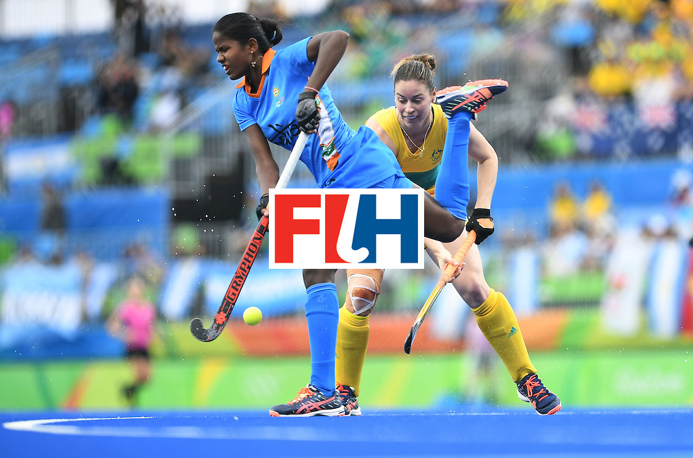India's Namita Toppo (L) vies for the ball with Australia's Karri McMahon during the women's field hockey India vs Australia match of the Rio 2016 Olympics Games at the Olympic Hockey Centre in Rio de Janeiro on August, 10 2016. / AFP / MANAN VATSYAYANA        (Photo credit should read MANAN VATSYAYANA/AFP/Getty Images)