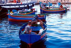 MALTA GOZO MGARR JUL00 - Maltese fisherman catch fish in the harbour of Mgarr, Gozo.. . jre/Photo by Jiri Rezac. . © Jiri Rezac 2000. . Tel:   +44 (0) 7050 110 417. Email: info@jirirezac.com. Web:   www.jirirezac.com