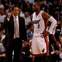 March 3, 2011; Miami, FL, USA; Miami Heat head coach Erik Spoelstra and shooting guard Dwyane Wade (3) during a game against the Orlando Magic at the American Airlines Arena. The Magic defeated the Heat 99-96.    Mandatory Credit: Derick E. Hingle