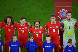 CARDIFF, WALES - Sunday, October 13, 2019: Wales' (L-R) Ethan Ampadu, Tom Lockyer, Joe Allen, Joe Rodon and goalkeeper Wayne Hennessey sing the national anthem before the UEFA Euro 2020 Qualifying Group E match between Wales and Croatia at the Cardiff City Stadium. (Pic by Paul Greenwood/Propaganda)