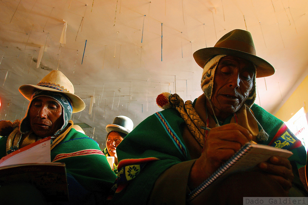 Aymara leaders Silverio Crispino, from right, Anacleto Ramosa and Filomena Quino, write down their communities demands and expectations for the upcoming Constitutional Assembly in the highlander village of Curahuara de Carangas, some 200 km southeast of Bolivian capital La Paz on Tuesday, June 20, 2006. Less than a week prior to July 2 elections for a national assembly, opposition to leftist government of Evo Morales claims that Venezuela's Hugo Chavez influence dominates run-up to Bolivia's vote on remaking its constitution, that could following Morales' radical social agenda, bring more transparency to this corruption-ridden, politically volatile nation and help eradicate racism that for half a millennium has kept a European-descended elite in political power and left the Indian majority poor and excluded.(Dado Galdieri)