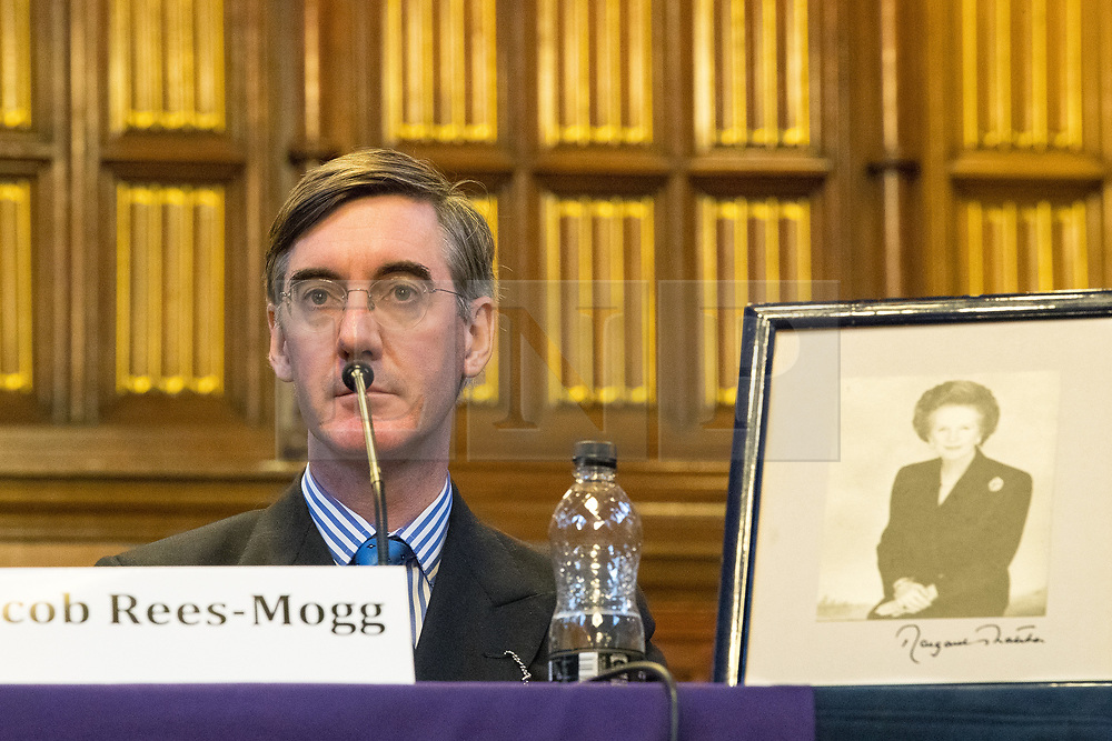 © Licensed to London News Pictures . 02/10/2017. Manchester, UK. JACOB REES-MOGG and a framed portrait of Margaret Thatcher , at a fringe , right-wing Bruges Group event at Manchester Town Hall during the second day of the Conservative Party Conference at the Manchester Central Convention Centre . Photo credit: Joel Goodman/LNP