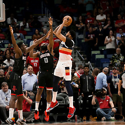 Mar 24, 2019; New Orleans, LA, USA; New Orleans Pelicans forward Anthony Davis (23) shoots over Houston Rockets guard James Harden (13) and forward Isaiah Hartenstein (55) during the first quarter at the Smoothie King Center. Mandatory Credit: Derick E. Hingle-USA TODAY Sports