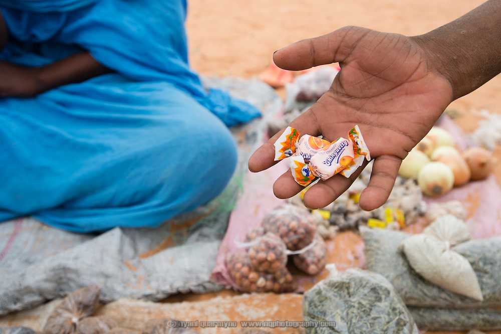 Sweets in a child's hand at the Mbera refugee camp for Malian refugees in southeastern Mauritania on 2 March 2013.