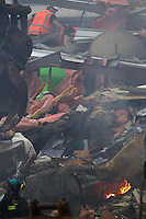 Rescue workers search through the debris of the CTV building in Christchurch City Centre after a Powerful earth quack ripped through Christchurch, New Zealand on Tuesday lunch time killing at least 65 people as it brought down buildings, buckled roads and damaged churches and the Cities Cathedral. Photo Tim Clayton