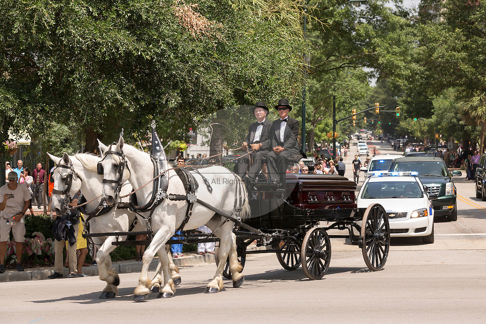 The horse-drawn caisson carrying the casket of slain State Senator Clementa Pinckney arrives at the State House June 24, 2015 in Columbia, South Carolina. Pinckney is one of the nine people killed in last weeks Charleston church massacre.