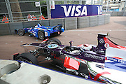 Sam Bird narrowly missing Sakon Yamamoto after crash in practice during the FIA Formula E Visa London ePrix  at Battersea Park, London, United Kingdom on 28 June 2015. Photo by Matthew Redman.