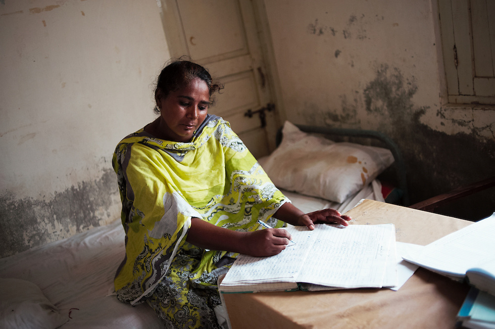 Inside the Tarqwaja Government Dispensary, Thatta, Sindh, Pakistan on June 30, 2011. Gulshukar Khawarja, a  government health worker in the clinic for the last 16 years. She has a daughter