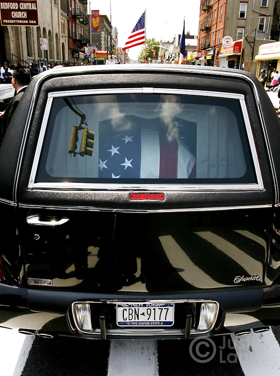 The casket of United States Marine Lance Cpl. Nicholas J. Whyte is seen in a hearse following his funeral at the Bedford Central Presbyterian Church in Brooklyn, New York on Friday 30 June 2006. Whyte was killed on 21 June 2006 while serving in Iraq.