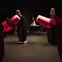 VENICE, ITALY - JUNE 21:  Whirling Dervishes of the Galata Mevlevi Ensemble, bow as part of the performance at Auditorium Candiani on June 21, 2011 in Venice, Italy. The whirling dance associated with Dervishes, is the practice of the Mevlevi Order in Turkey, and is part of a formal ceremony known as the Sema which is only one of the many Sufi ceremonies performed to try to reach religious ecstasy