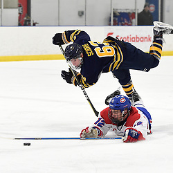 TORONTO, ON  - JAN 7,  2018: Ontario Junior Hockey League game between the Toronto Jr. Canadiens and the Buffalo Jr. Sabres, Jeremy Smith #12 of the Toronto Jr. Canadiens keeps the puck from Michael Sciore #63 of the Buffalo Jr. Sabres during the first period.<br /> (Photo by Andy Corneau / OJHL Images)