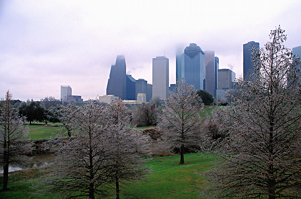 Stock photo of an early morning view of the Houston downtown skyline from Buffalo Bayou after winter ice storms cover the Bank of America building, One Shell Plaza, and Wells Fargo Plaza