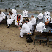 France, Paris December 2015 COP 21 UN Climate Conference. A group of Danish activists dressed as polar bears coordinated by Danish artist Jens Galschiot. Having a picnic by the Seine.