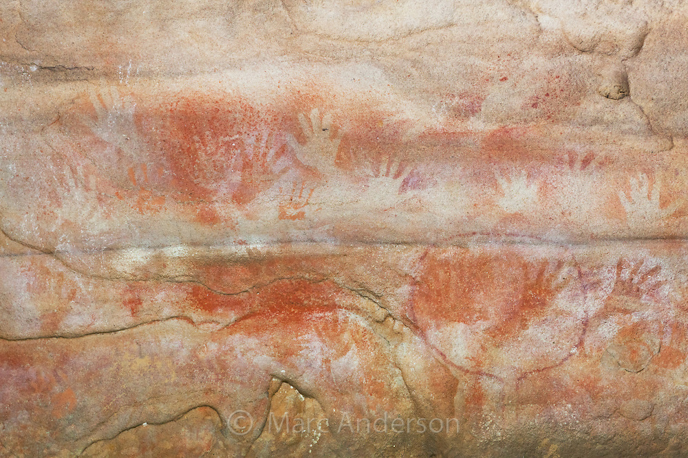 Layers of hand prints and stencils in Red Hands Cave; one of the best examples of Aboriginal art in the Blue Mountains National Park, NSW, Australia