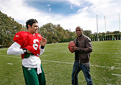 "October 8, 2009; Florham Park, NJ; USA; Floyd ""Money"" Mayweather and New York Jets QB Mark Sanchez talk after the New York Jets practice in Florham Park, NJ."