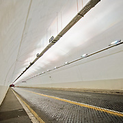 ROME, Italy - Underground road tunnel in downtown Rome, with converging lines and diminishing perspective.