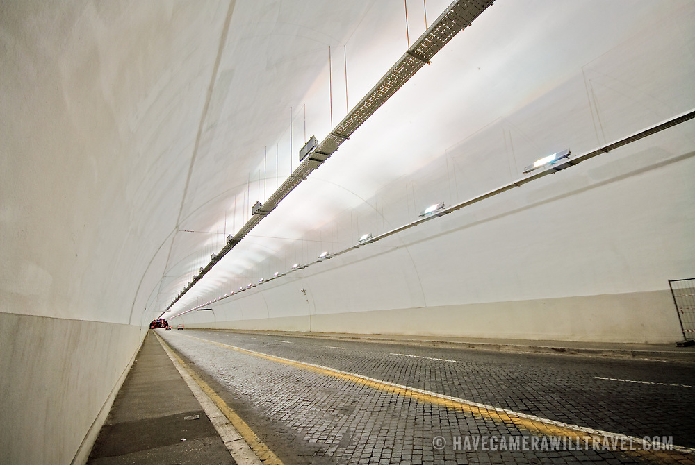 Underground road tunnel in downtown Rome, with converging lines and diminishing perspective.