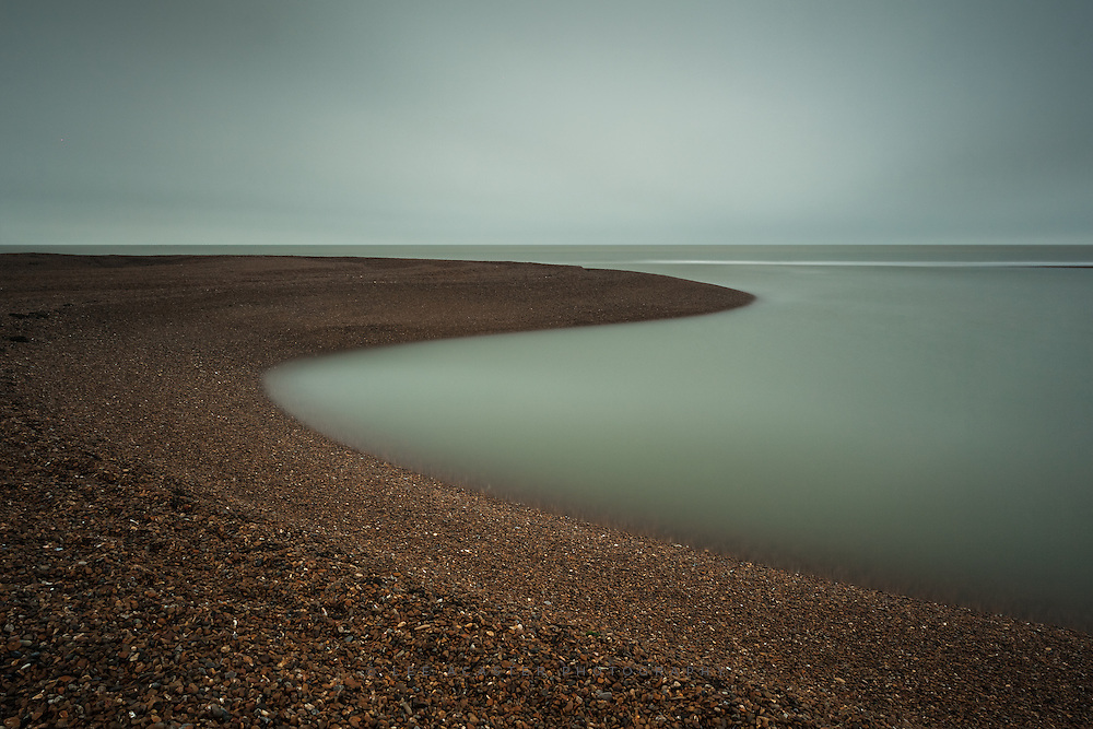 Took a trip Shingle Street again this morning. Was a grey and drizzly day, but that just added to the sense of remoteness and otherworldliness you get can get there, with the eerily still water in th elagoons lapping against the shingle banks.