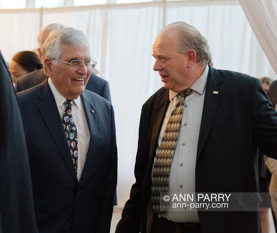 Garden City, New York, U.S. June 6, 2019. At left, Apollo 7 astronaut HARRISON SCHMITT is about to walk through entrance curtain, at Cradle of Aviation Museum, to Apollo at 50 Anniversary Dinner, an Apollo astronaut tribute celebrating the Apollo 11 mission Moon landing.