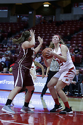 01 November 2017: Megan Talbot looks at the hoop while guarded by Samantha Sarnes during a Exhibition College Women's Basketball game between Illinois State University Redbirds the Red Devils of Eureka College at Redbird Arena in Normal Illinois.