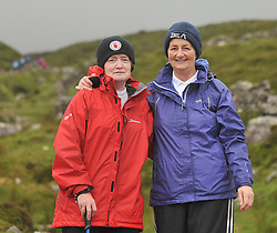 Celia Rooney from Belfast and Mercedes Cohen from the Sisters of St Clare, Keady Armagh on their way down Croagh Patrick on reek sunday.<br /> Pic Conor McKeown