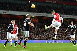 Arsenal's Jack Wilshere heads the ball - Photo mandatory by-line: Mitchell Gunn/JMP - Tel: Mobile: 07966 386802 23/11/2013 - SPORT - Football - London - Emirates Stadium - Arsenal v Southampton - Barclays Premier League