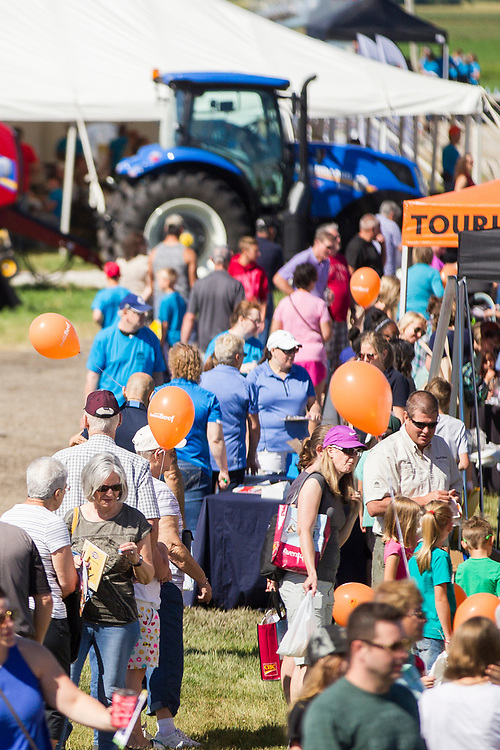 Attendees take in some of the many boots at the Breakfast on the Farm event near Shedden, Ontario, Saturday, June 24, 2017.<br /> Farmers Forum/ Geoff Robins