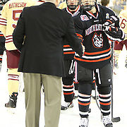 Ryan Belonger #16 of the Northeastern Huskies shakes hands with Head Coach Jerry York of the Boston College Eagles following The Beanpot Championship Game at TD Garden on February 10, 2014 in Boston, Massachusetts. (Photo by Elan Kawesch)