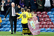 Burnley Manager Sean Dyche high fives the mascots during the Premier League match between Burnley and West Ham United at Turf Moor, Burnley, England on 9 November 2019.