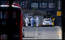 June 4, 2017 - London, London, United Kingdom - Image ©Licensed to i-Images Picture Agency. 04/06/2017. London, United Kingdom. London Bridge Terror Attack. The aftermath of the Terror attack on London Bridge and Borough market on Saturday 3rd June, 2017. Scenes of crime officers investigating the scene on London Bridge after the terror attack took place on Saturday night Picture by Andrew Parsons / i-Images (Credit Image: © Andrew Parsons/i-Images via ZUMA Press)