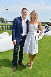 BRENDAN COLE and his wife ZOE at the Audi International Polo at Guards Polo Club, Windsor Great Park, Egham, Surrey on 26th July 2014.