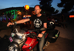 13.07.2011., Petrcane, Zadar, Croatia - Music publicist Greg Parmley, chief-editor of the British magazine IQ, is going to try for a Guiness World Record achievement. He is going to try to visit 26 festivals across the Europe on his motorbike during only 30 days.In his attempt to achieve a new world record Parmley is planning to visit 13 states on his motorbike BMW R1200R Classic and ride more than 8850 kilometres. Now, he is in Petrcane on Garden festival. .                                                                                                    Foto ©  nph / PIXSELL       ****** out of GER / CRO  / BEL ******