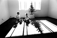Children play next to the christmas tree in the thier new San Jose apartment, after moving there from the homeless shelter.