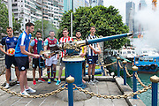 HKFC Citi Soccer Sevens Press conference at the historic Noon Day gun on Victoria Harbour Hong Kong. The one shot salute is a long standing Hong Kong tradition. Leicester City player Elliott Moore fires the gun.Players L to R- HKFC Gary Gheczy,Leicester City Elliott Moore, Aston Villa Khalid Abdo, West Ham Lewis Page, Stoke City Lewis Banks, Wellington Phoenix Justin Gulley and Newcastle United Dan Barlaser.