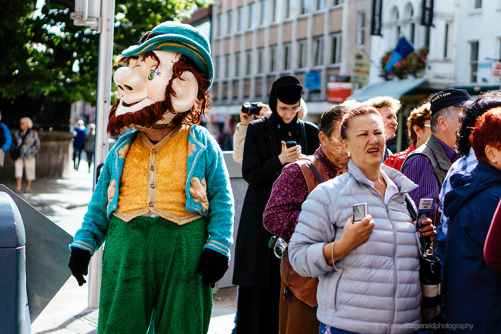 Lepruchan looks desperately for his pot of gold among the tourists on Grafton Street