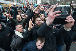 "© Licensed to London News Pictures . 18/03/2018 . London , UK . Supporters of Tommy Robinson and Martin Sellner celebrate the speech going ahead after Tommy Robinson leaves . 1000s including supports of alt-right groups such as Generation Identity and the Football Lads Alliance , at Speakers' Corner in Hyde Park where Tommy Robinson reads a speech by Generation Identity campaigner Martin Sellner . Along with Brittany Pettibone , Sellner was due to deliver the speech last week but the pair were arrested and detained by police when they arrived in the UK , forcing them to cancel an appearance at a UKIP "" Young Independence "" youth event , which in turn was reportedly cancelled amid security concerns . Photo credit: Joel Goodman/LNP"