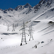 Pylons and powerlines transporting electricity from the Uzbek border to the city of Kabul crossing the Salang Pass.