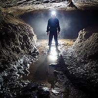 Man in cave underground