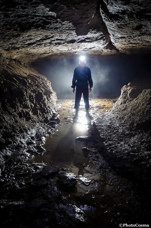 Man in cave underground