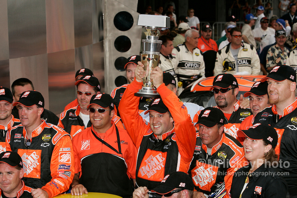 Tony Stewart's crew celebrates winning the Allstate 400 at the Brickyard at the Indianapolis Motor Speedway Aug 7, 2005.