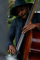 """The 12th annual Hyde Park Jazz Festival was held this weekend, Saturday, September 29th and Sunday, September 30th, 2018 at various venues around Hyde Park. Jazz musicians from all around came out to play at the two-day event. <br /> <br /> Basist, Junius Paul performed Sunday afternoon on the Midway Plaisance located at 1130 Midway Plaisance on the University of Chicago campus.<br /> <br /> Please 'Like' """"Spencer Bibbs Photography"""" on Facebook.<br /> <br /> Please leave a review for Spencer Bibbs Photography on Yelp.<br /> <br /> Please check me out on Twitter under Spencer Bibbs Photography.<br /> <br /> All rights to this photo are owned by Spencer Bibbs of Spencer Bibbs Photography and may only be used in any way shape or form, whole or in part with written permission by the owner of the photo, Spencer Bibbs.<br /> <br /> For all of your photography needs, please contact Spencer Bibbs at 773-895-4744. I can also be reached in the following ways:<br /> <br /> Website – www.spbdigitalconcepts.photoshelter.com<br /> <br /> Text - Text """"Spencer Bibbs"""" to 72727<br /> <br /> Email – spencerbibbsphotography@yahoo.com<br /> <br /> #SpencerBibbsPhotography #HydePark #Community #Neighborhood<br /> #Music<br /> #HydeParkJazzFestival<br /> #Jazz<br /> #LiveMusic"""