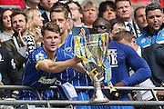 Jake Reeves lifting the trophy after winning the Sky Bet League 2 play off final match between AFC Wimbledon and Plymouth Argyle at Wembley Stadium, London, England on 30 May 2016.