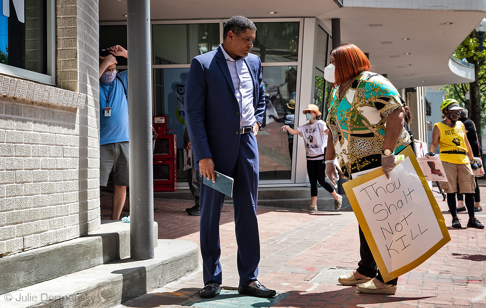Rep .Cedric Richmond talking to activist after he held a call-in townhall event at the Advocate's office in New Orleans . Members of the Concerned Citizens of St John and members of the Coalition Against Death Alley wanted to bring attention to the fact no questions about the role pollution from the petrochemical plants in river parishes has on the high number of deaths from COVID-19 in the African American community that live near the plants were taken at Richmond's last event.