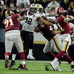 Oct 8, 2018; New Orleans, LA, USA New Orleans Saints defensive end Marcus Davenport (92) forces a fumble by Washington Redskins quarterback Alex Smith (11) during the third quarter at the Mercedes-Benz Superdome. The Saints defeated the Redskins 43-19.