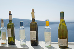 wine bottles on a ledge in Santorini, Greece