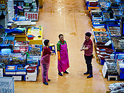 06 JUNE 2018 - SEOUL, SOUTH KOREA: Retail workers in the Noryangjin Fish Market wait for customers. The Noryangjin Fish Market is the largest fish market in Seoul and has been in operation since 1927. It opened in the current location in 1971 and was renovated in 2015. The market serves both retail and wholesale customers and has become a tourist attraction in recent years.     PHOTO BY JACK KURTZ